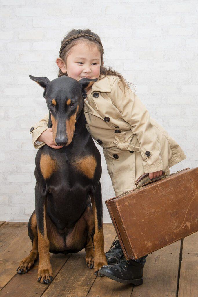 Doberman And Girl